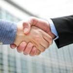 Handshake John Downes - acorro